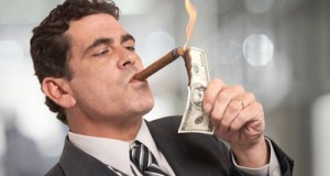 lighting cigar with money