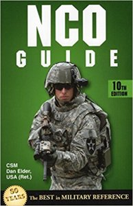 NCO Guide- Soldier holding a weapon
