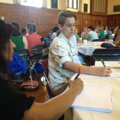 SSI 2015 participants take notes during plenary address.