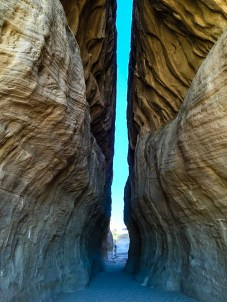 In the middle of the Jeberl Ithlib is a natural slit that measures 131 feet called the Siq, a dim narrow gorge, after a similar corridor in Petra.