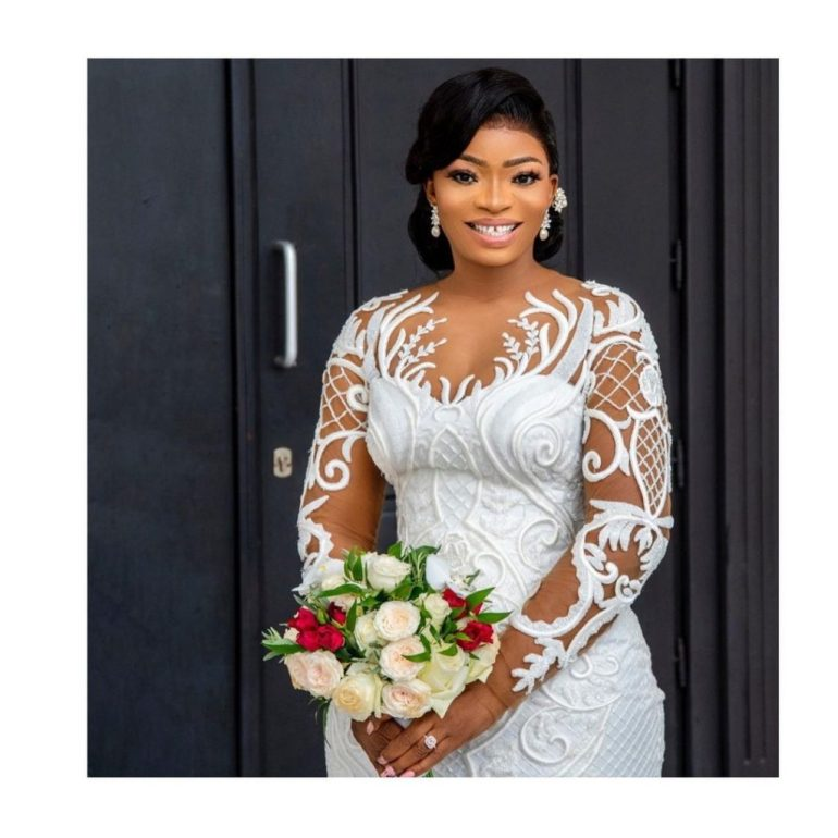 wedding dress with embroidered lace overlay april by kunbi