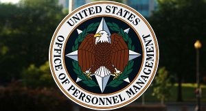 A stylized bald eagle is encircled by a laurel wreath. Encircling the bald eagle and laurel wreath is text reading United States: Office of Personnel Management in black ink against a white background.