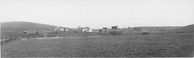 Albert Bates and the Lone Maple Company Dryer, Red Hills, Salem, Oregon, 1915. Dryer is building towards center of photo. There is a creek next to the dryer named Battle Creek. The photographer wrote that Indians used to come and steal food and frighten women left alone into cooking for them. From Rosedale a group of men gathered on a Sunday morning and shot at Indians hiding in the alder brush waiting for the women to be left alone. One Indian was shot in the loins and another was nicked by a bullet. The Indians ran away and never came back. The photographer notes it wasn't much of a battle to name a creek after. Bush House Museum, Salem Art Association Photo ID number bhp0299