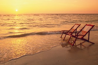 sunset-beach-chairs-stock-footage