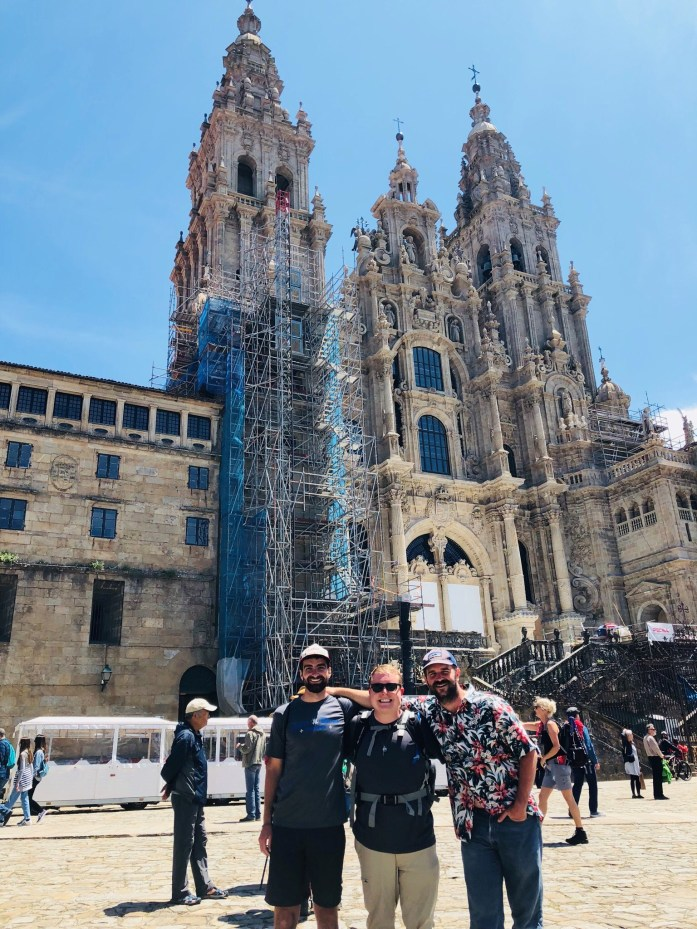 Seminarians Collin Clark (New Orleans), Michael Beverung (Lake Charles), and Sam Bond (Lake Charles) in Santiago de Compostela, Spain in front of the Cathedral after they spent weeks traveling the Camino de Santiago.