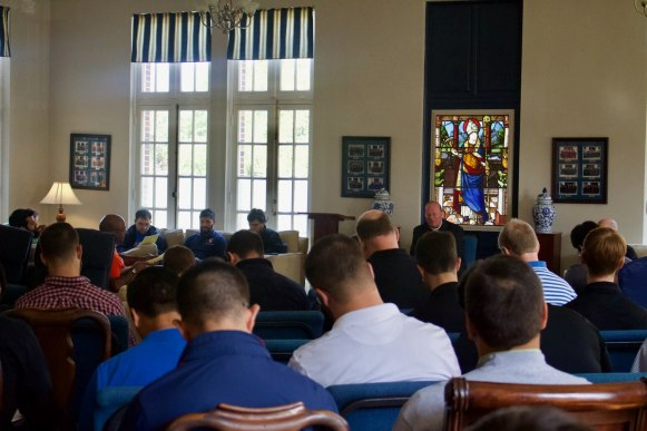 The new seminarian class introductions in the family room on the first day of orientation.