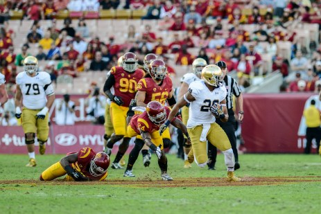 Irish junior running back C.J. Prosise attempts to outrun USC defenders.
