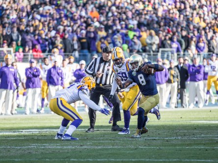 Irish quarterback Malik Zaire attempts to evade defenders.