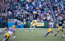 Irish wide receiver Will Fuller leaps into the air to make a catch.