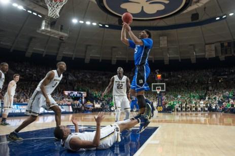 Duke freshman center Jahlil Okafor takes a shot after knocking down freshman forward Bonzie Colson. Michael Yu | The Observer