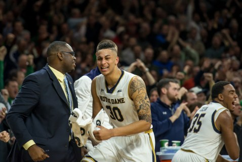 Junior forward Zach Auguste reacts to sophomore guard; Steve Vasturia's 3-pointer. Michael Yu | The Observer