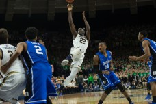 Irish senior guard Jerian Grant hits an off-balance runner as the shot clock expires to put Notre Dame up three with 1:07 to play Wednesday. Michael Yu | The Observer