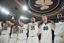 Notre Dame players celebrate after improving to 20-2 on the season following a 77-73 win over Duke at Purcell Pavilion on Wednesday. Michael Yu | The Observer