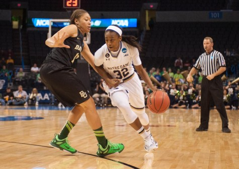 Irish junior guard Jewell Loyd drives past Baylor sophomore guard Alexis Prince during Sunday's Elite Eight game.