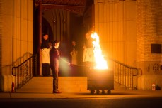 Congregation of Holy Cross members prepare The Blessing of the Fire outside the Basilica of the Sacred Heart.