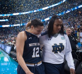 Sophomore forward Taya Reimer (left) walks off the court with sophomore forward Kristina Nelson following the 63-53 defeat of the Irish by Connecticut on Tuesday.