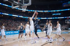 Irish junior guard Jewell Loyd elevates for a shot against Connecticut's Breanna Stewart during Tuesday's 63-53 loss.