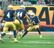 Irish freshman receiver C.J. Sanders makes a cut during a kick return in Notre Dame's 44-28 loss to Ohio State on Friday.