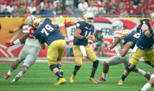 Irish sophomore quarterback DeShone Kizer steps up in the pocket during Notre Dame's 44-28 loss to Ohio State on Friday. Kizer finished the game with 284 yards and two touchdowns through the air.