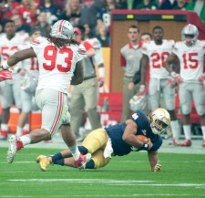 Irish sophomore quarterback DeShone Kizer falls to the ground after scrambling during Notre Dame's 44-28 defeat against Ohio State in the Fiesta Bowl on Friday in Glendale, Arizona.