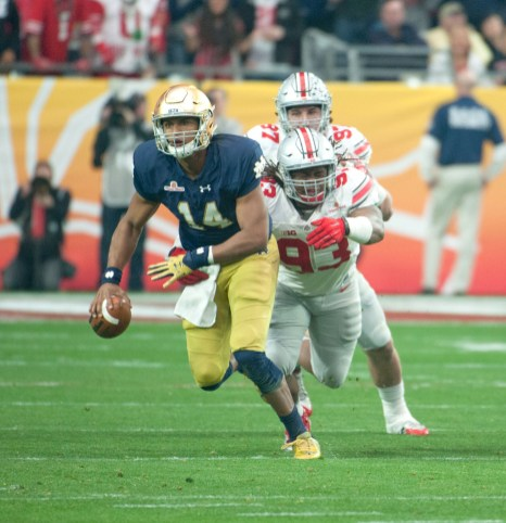 Irish sophomore quarterback DeShone Kizer scrambles from Buckeyes sophomore defensive lineman Tracy Sprinkle during Notre Dame's 44-28 loss to Ohio State. Kizer ended the game with 21 rushing yards and a score on the ground, his 10th of the season.