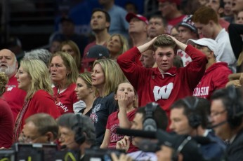 A Wisconsin fan reacts after officials overturn a charge call.