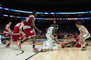 Irish senior forward Zach Auguste fights for a loose ball in the final minute of Notre Dame's 61-56 win over Wisconsin on Friday.