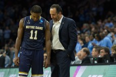 Irish junior guard Demetrius Jackson and head coach Mike Brey talk during Notre Dame's 88-74 defeat to North Carolina at Wells Fargo Center.