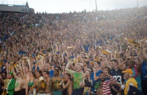 In a file photo from 2016, the Notre Dame student section cheers on the football team with rally towels in hand.