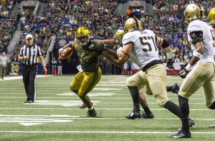 A Notre Dame players tries to break a tackle in Notre Dame's 44-6 win vs. Army.