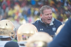Irish head coach Brian Kelly addresses his team on the field during halftime.
