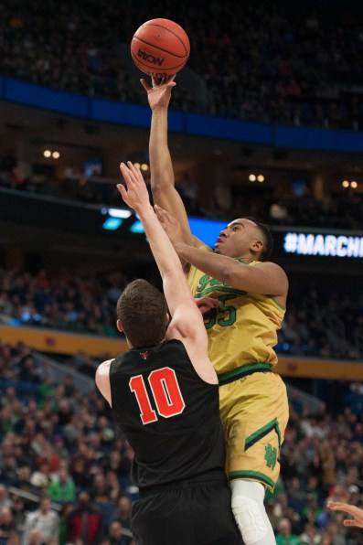 Irish junior forward Bonzie Colson attempts to make a jump shot over a Princeton defender.