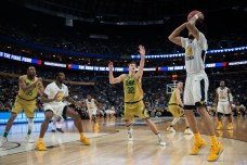 Irish senior guard Steve Vasturia attempts to block a shot during Saturday's 81-73 second-round loss to West Virginia in Buffalo, New York.