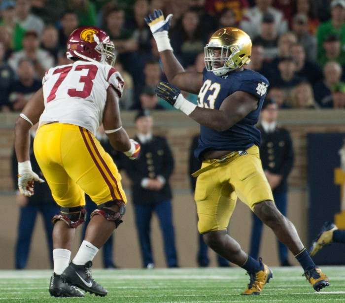 Irish senior defensive lineman Jay Hayes rushes past a USC defender during Notre Dame's 49-14 win over the Trojans on Sat. at Notre Dame Stadium.