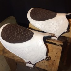 White and Brown Roman Riding Pads