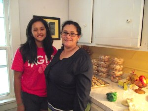 Dolores (joined on the left by her daughter Frieda) is proud to work with her family, who helps out with her baking.