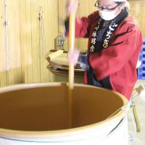 Brewer making sake at Watanabesahei Sake Brewery nearby Tokyo