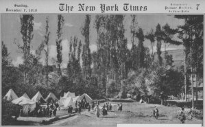 A cover of the New York Times with a photo of refugees tents.