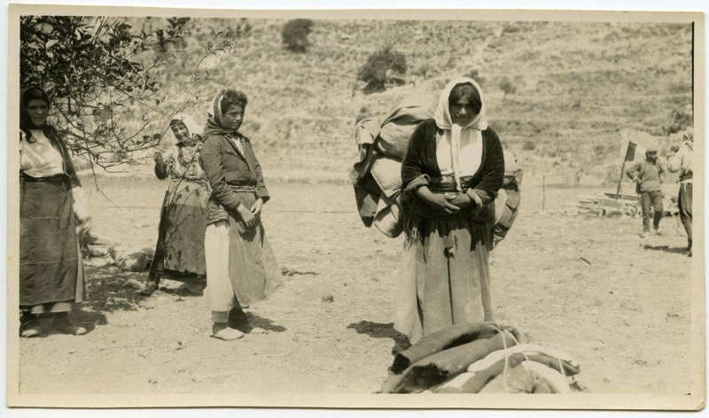 Women refugees carrying bundles on their backs