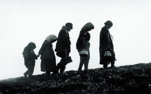 Five young people walking from Turkey to safety in Syria. A version of this photograph also appeared on the cover of the New Near East magazine in April 1923