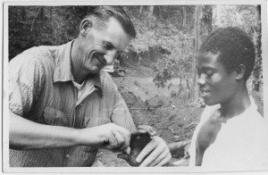 Near East Foundation physican Dr. Emery Howard cares for a young patient in Ghana.