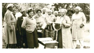 Members of the local home economics department show off their beekeeping skills. The women received training and equipment through the Near East Foundation.