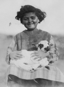 Young girl holding a baby goat
