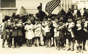 Young children from Syra Orphanage receive dolls donated by well-wishers in the United States.