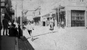 Boys running on a city street