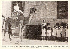 Orphans with camel at Christmas
