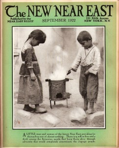 A New Near East magazine cover showing a girl and a boy using a simple cooking stove. Although they are clad in simple garments, the children are tidy and clean. Near East Relief strove to present images of industrious Near East Relief children to counterbalance the images of needy orphans that saturated the media.