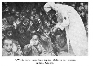Nurse inspecting children for scabies