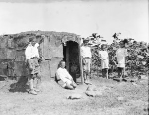 Boys pose with a hut that they built themselves in the garden at Polygon Orphanage, which was part of the orphanage complex at Alexandropol. Polygon doubled as an agricultural school.