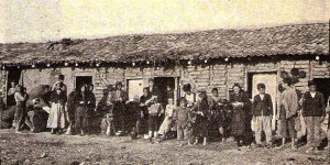 Men, women, and children standing in front of Rodosto cottages